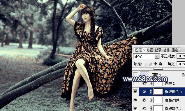 Photoshop调出深蓝色效果的树林美女写真图片