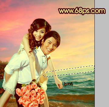 PS调色调出唯美彩霞背景的海景婚纱照片