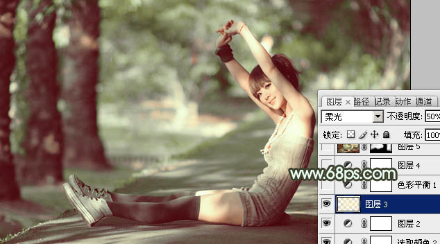 Photoshop调出深绿色树阴底下的女孩照片