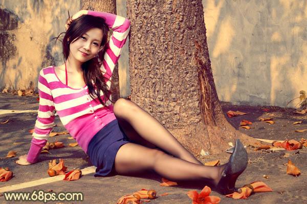 Photoshop调出暗红色的树底下丝袜美女照片